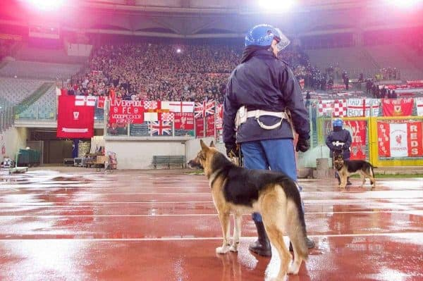 ROME, ITALY - Thursday, February 15, 2001: An Itanlian policeman and dog watches over the travelling Liverpool supporters during the UEFA Cup 4th Round 1st Leg match at the Stadio Olimpico. (Pic by David Rawcliffe/Propaganda)