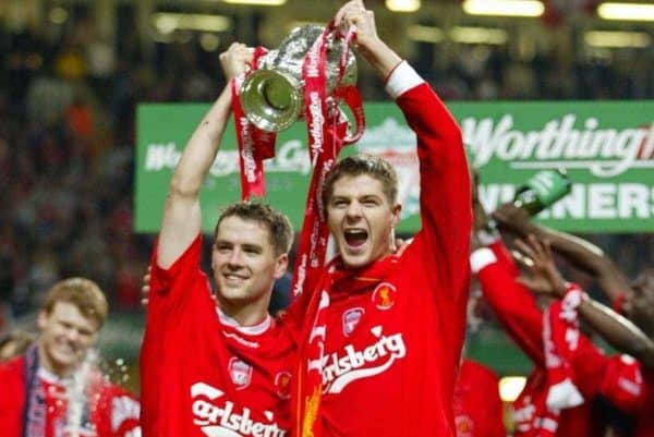 Liverpool's goalscorers Michael Owen (l) and Steven Gerrard celebrate beating Manchester United 2-0 during the Football League Cup Final at the Millennium Stadium. (Pic by David Rawcliffe/Propaganda)