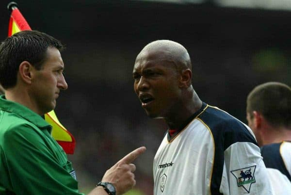 Liverpool's El-Hadji Diouf argues with a biased linesman against Manchester United during the Premiership match at Old Trafford. (Pic by David Rawcliffe/Propaganda)