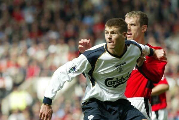 MANCHESTER, ENGLAND - Saturday, April 5, 2003: Liverpool's Stephen Gerrard and Manchester United's Phil Neville during the Premiership match at Old Trafford. (Pic by David Rawcliffe/Propaganda)