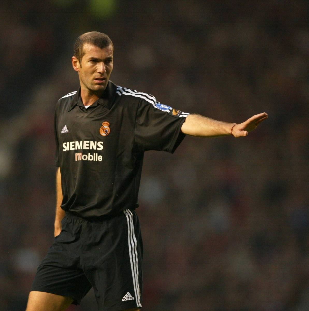 MANCHESTER, ENGLAND - Wednesday, April 23, 2003: Real Madrid's Zinedine Zidane in action against Manchester United during the UEFA Champions League Quarter Final 2nd Leg match at Old Trafford. (Pic by David Rawcliffe/Propaganda)