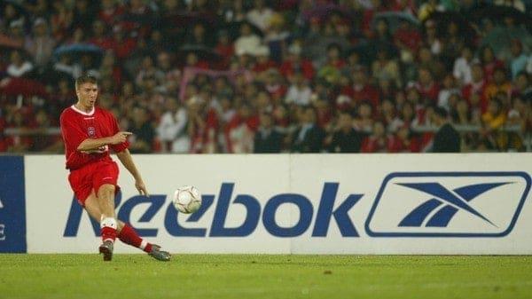 BANGKOK, THAILAND - Thailand. Thursday, July 24, 2003: Liverpool's Gregory Vignal in front of a Reebok ad board during a preseason friendly match at the Rajamangala National Stadium. (Pic by David Rawcliffe/Propaganda)