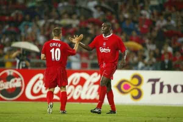 BANGKOK, THAILAND - Thailand. Thursday, July 24, 2003: Liverpool's Emile Heskey (r) celebrates his goal against Thailand with team-mate Michael Owen during a preseason friendly match at the Rajamangala National Stadium. (Pic by David Rawcliffe/Propaganda)