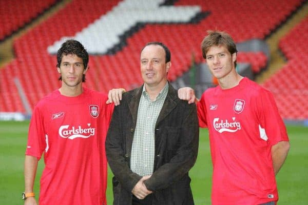 LIVERPOOL, ENGLAND - WEDNESDAY AUGUST 25th 2004: Liverpool's manager Rafael Benitez poses with his two new Spanish signings Luis Garcia (l) and Xabi Alonso (r) at Anfield. (Photo by David Rawcliffe/Propaganda)