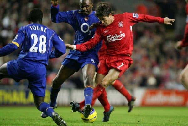 LIVERPOOL, ENGLAND- SUNDAY NOVEMBER 28th 2004: Liverpool's Harry Kewell tackled by Arsenal's Patrick Vieira and Kolo Toure during the Premiership match at Anfield. (Pic by David Rawcliffe/Proparganda)