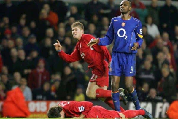 LIVERPOOL, ENGLAND- SUNDAY NOVEMBER 28th 2004: Liverpool's Neil Mellor celebrates scoring the winning goal in injury time as Arsenal's Patrick Vieira looks on dejected during the Premiership match at Anfield. (Pic by David Rawcliffe/Proparganda)