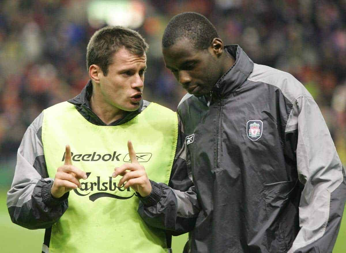 LIVERPOOL, ENGLAND - TUESDAY JANUARY 11th 2005: Liverpool's Jamie Carragher chats with team-mate Djimi Traore before the League Cup Semi-Final 1st Leg at Anfield. (Pic by David Rawcliffe/Propaganda)