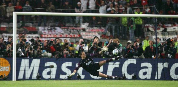 Liverpool's Jerzy Dudek saves the last penalty to win the European Cup against AC Milan during the UEFA Champions League Final at the Ataturk Olympic Stadium, Istanbul. (Pic by David Rawcliffe/Propaganda)