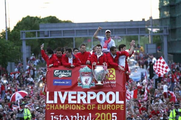 LIVERPOOL, ENGLAND - THURSDAY, MAY 26th, 2005: Liverpool players (L-R) Luis Garcia, Steven Finnan, Jamie Carragher, Dietmar Hamann, John Arne Riise, Jerzy Dudek, Xabio Alonso with coach Pako Ayesteran (top) parade the European Champions Cup on on open-top bus tour of Liverpool in front of 500,000 fans after beating AC Milan in the UEFA Champions League Final at the Ataturk Olympic Stadium, Istanbul. (Pic by David Rawcliffe/Propaganda)