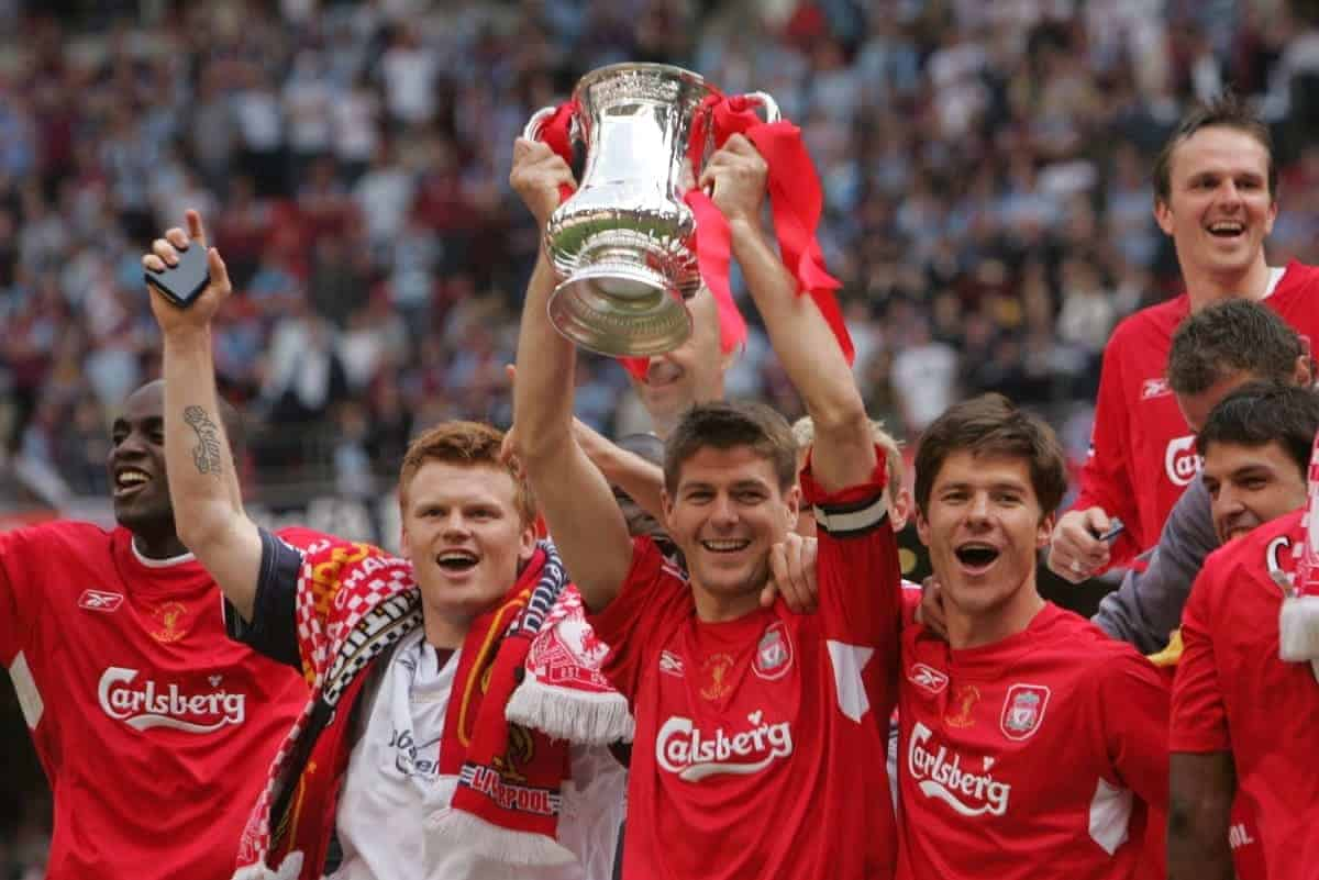 CARDIFF, WALES - SATURDAY, MAY 13th, 2006: Liverpool's captain Steven Gerrard lifts the FA Cup surrounded by team-mates L-R Momo Sissoko, John Arne Riise and Xabi Alonso after beating West Ham United on penalties during the FA Cup Final at the Millennium Stadium. (Pic by David Davies/Pool/Propaganda)
