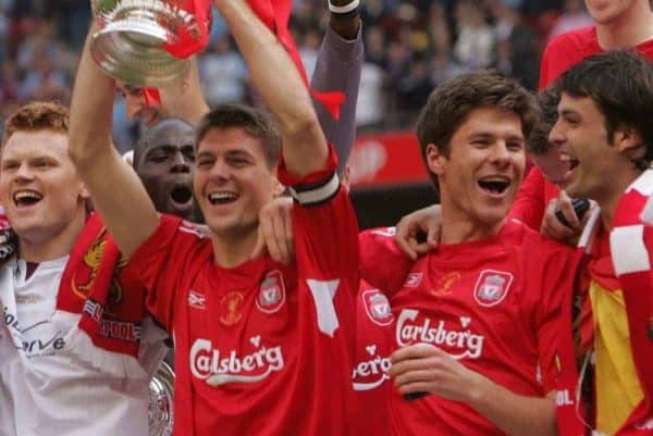 CARDIFF, WALES - SATURDAY, MAY 13th, 2006: Liverpool's captain Steven Gerrard lifts the FA Cup surrounded by team-mates L-R Momo Sissoko, John Arne Riise, Xabi Alonso and Fernando Morientes after beating West Ham United on penalties during the FA Cup Final at the Millennium Stadium. (Pic by David Davies/Pool/Propaganda)