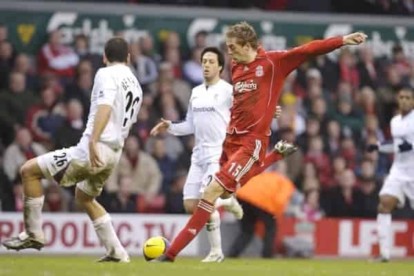 Liverpool's Peter Crouch shoots against Bolton Wanderers during the Premiership match at Anfield. (Pic by David Rawcliffe/Propaganda)