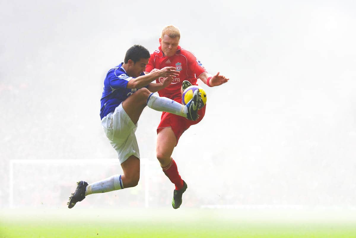 Liverpool, England - Saturday, February 3, 2007: Liverpool's John Arne Riise and Everton's Tim Cahill during the Merseyside Derby Premiership match at Anfield. (Pic by David Rawcliffe/Propaganda)
