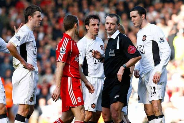 Liverpool, England - Saturday, March 3, 2007:  Manchester United players Michael Carrick, Gary Neville and John O'Shea surround the referee, as is their custom when a decision goes against them, after he sent off Paul Scholes for an assault on Liverpool's Xabi Alonso during the Premiership match at Anfield. (Pic by David Rawcliffe/Propaganda)