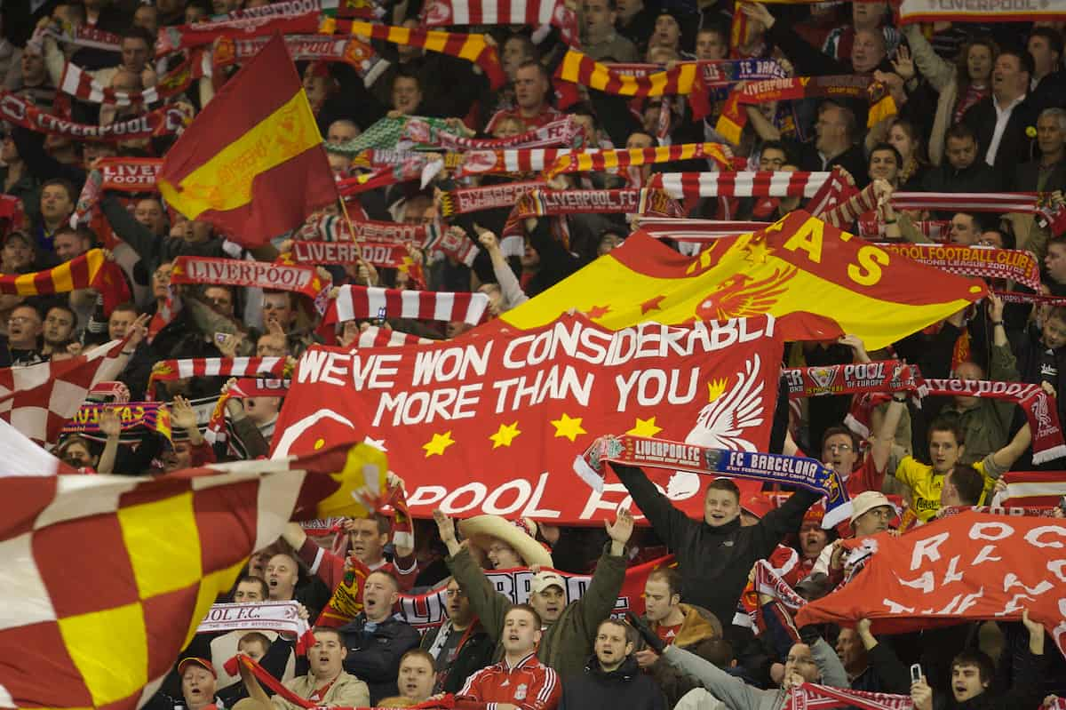 Liverpool, England - Tuesday, March 6, 2007: Liverpool fans sing 'You'll Never Walk Alone' and wave flags and scarves on the famous Spion Kop during the UEFA Champions League First Knockout Round 2nd Leg against FC Barcelona at Anfield. (Pic by David Rawcliffe/Propaganda)