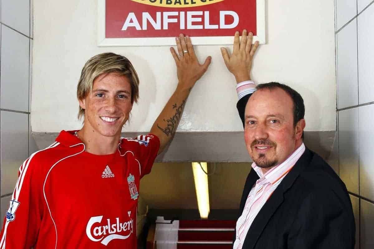 Liverpool, England - Wednesday, July 4, 2007: Liverpool's new signing Fernando Torres with manage Rafael Benitez under the famous This is Anfield sign following his £26m transfer from Atletico Madird, a club record transfer fee. (Photo by David Rawcliffe/Propaganda)