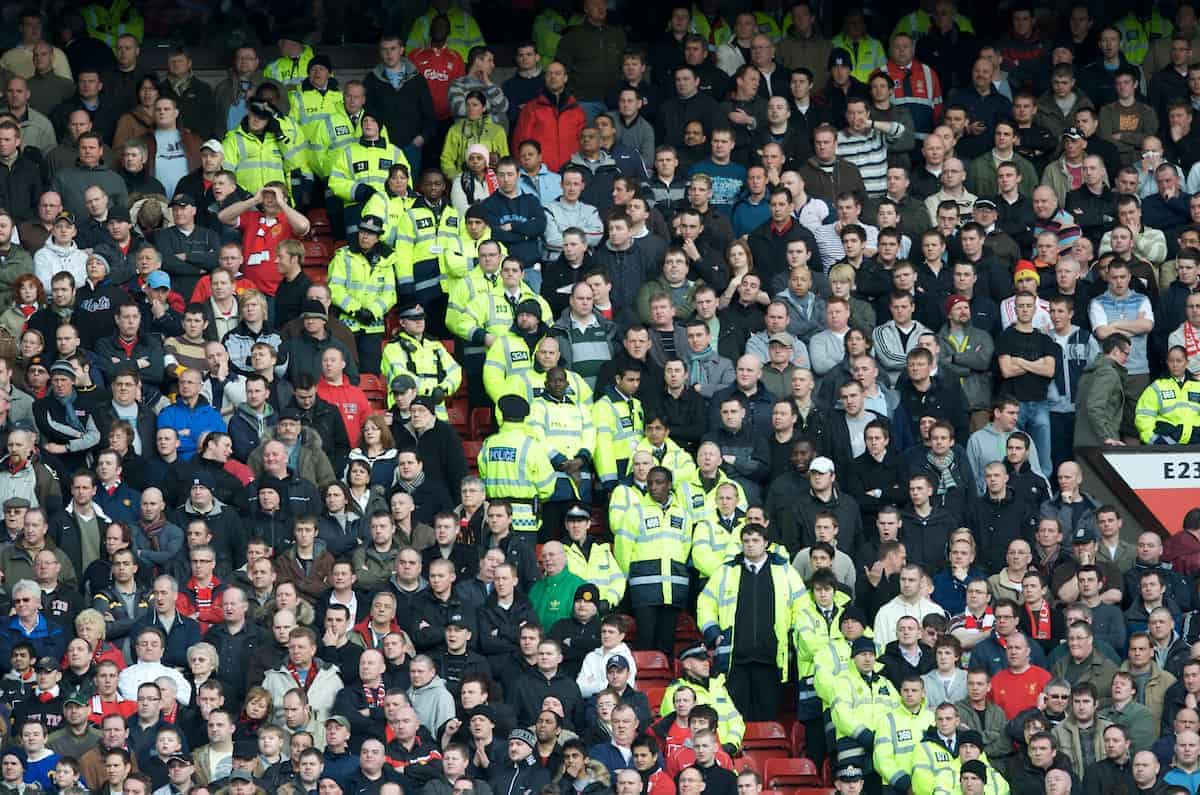 MANCHESTER, ENGLAND - Sunday, March 23, 2008: Liverpool fans are protected from the Manchester United fans by stewards and police during the Premiership match at Old Trafford. (Photo by David Rawcliffe/Propaganda)