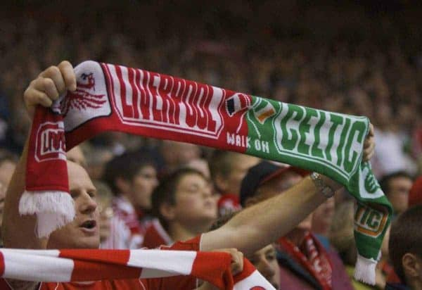 LIVERPOOL, ENGLAND - Sunday, May 4, 2008: A Liverpool fan holds up a scarf with Liverpool and Glasgow Celtic on during the Premiership match at Anfield. (Photo by David Rawcliffe/Propaganda)
