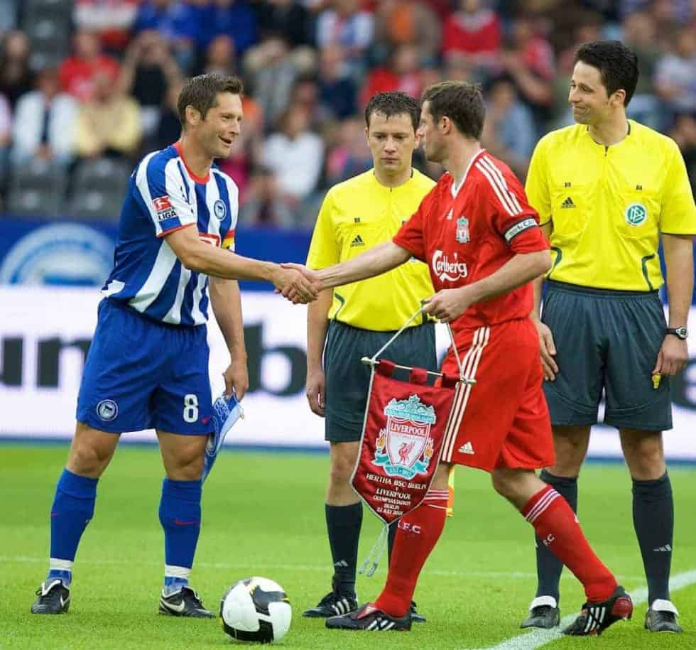 BERLIN, GERMANY - Tuesday, July 22, 2008: Liverpool's captain Jamie Carragher shakes hands with Hertha BSC Berlin's captain Pal Dardal during a pre-season friendly match at the Olympiastadion. (Photo by David Rawcliffe/Propaganda)