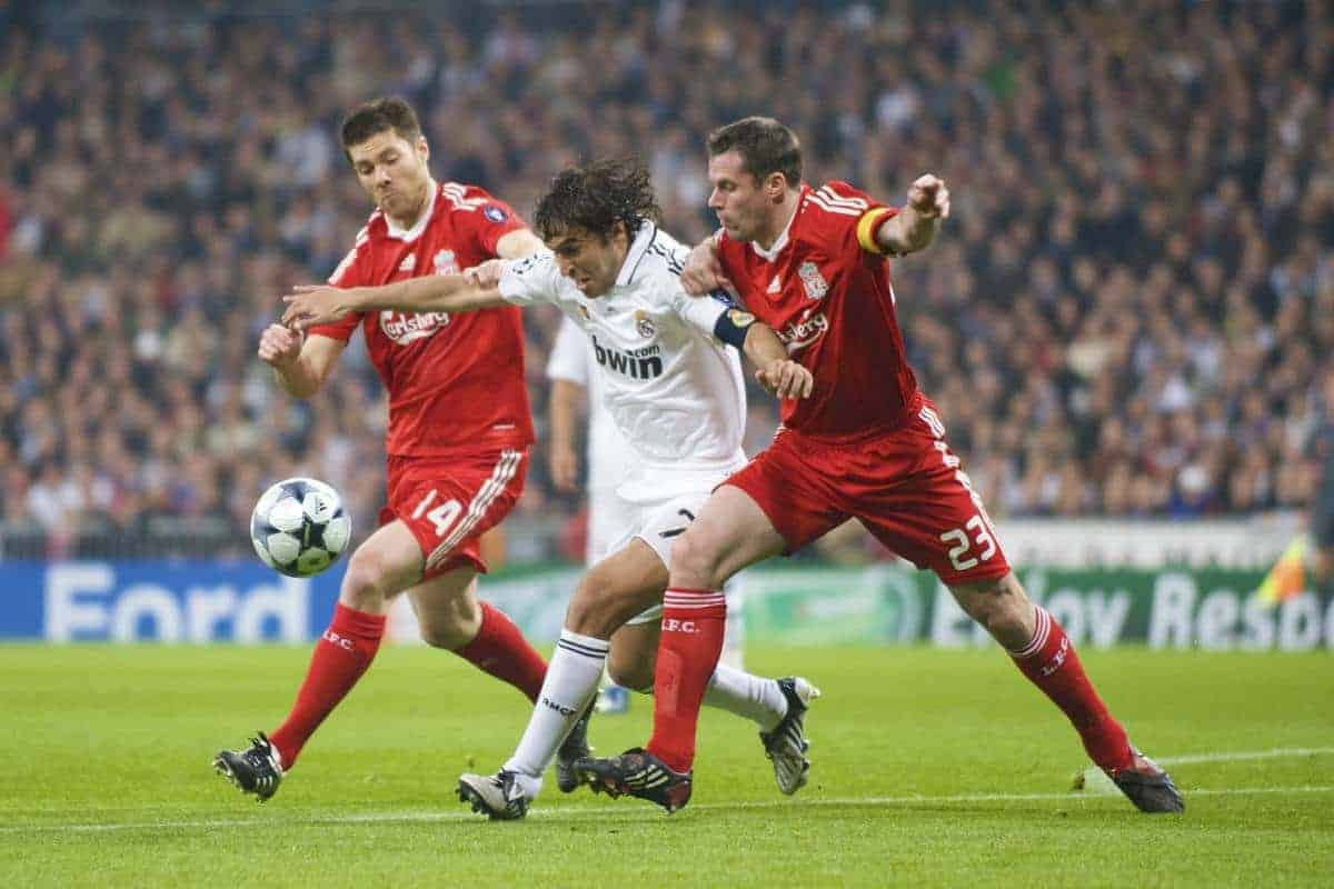 MADRID, SPAIN - Wednesday, February 25, 2009: Liverpool's Jamie Carragher and Xabi Alonso tackle Real Madrid's Raul Gonzalez during the UEFA Champions League First Knock-Out Round at the Santiago Bernabeu. (Photo by David Rawcliffe/Propaganda)