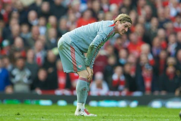 MANCHESTER, ENGLAND - Saturday, March 14, 2009: Liverpool's Fernando Torres takes a knock during the Premiership match against Manchester United at Old Trafford. (Photo by David Rawcliffe/Propaganda)