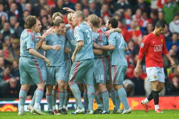 MANCHESTER, ENGLAND - Saturday, March 14, 2009: Liverpool's Fabio Aurelio is mobbed by team-mates after scoring his side's third goal against Manchester United during the Premiership match at Old Trafford. (Photo by David Rawcliffe/Propaganda)