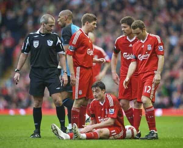 LIVERPOOL, ENGLAND - Sunday, March 22, 2009: Liverpool's Albert Riera is left on the floor after a nasty tackle by Aston Villa's John Carew during the Premiership match at Anfield. (Photo by David Rawcliffe/Propaganda)