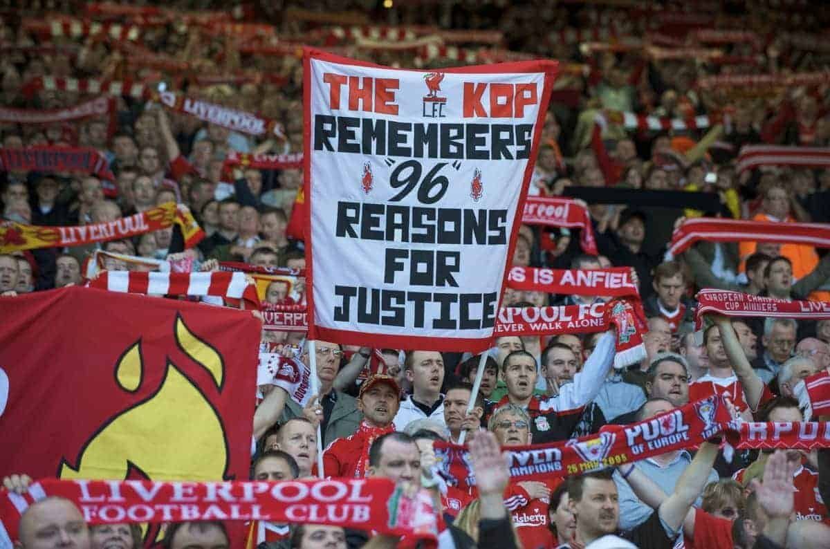 LIVERPOOL, ENGLAND - Saturday, April 11, 2009: Liverpool's supporters on the Spion Kop display a banner calling for justice, before the 20th anniversary of the Hillsborough Stadium Disaster, which claimed the lives of 96 supporters. (Photo by: David Rawcliffe/Propaganda)