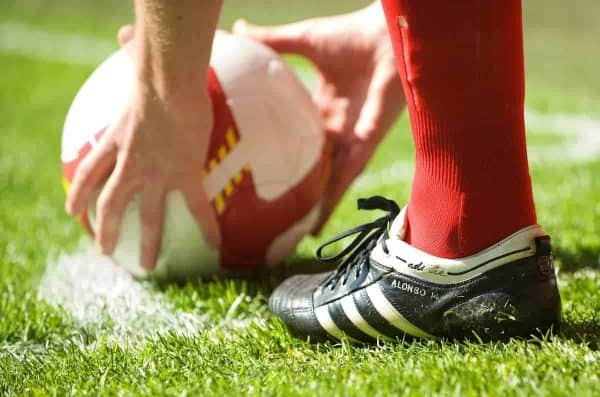 LIVERPOOL, ENGLAND - Saturday, April 11, 2009: The adidas boots of Liverpool's Xabi Alonso as he prepares to take a corner-kick during the Premiership match against Blackburn Rovers at Anfield. (Photo by: David Rawcliffe/Propaganda)