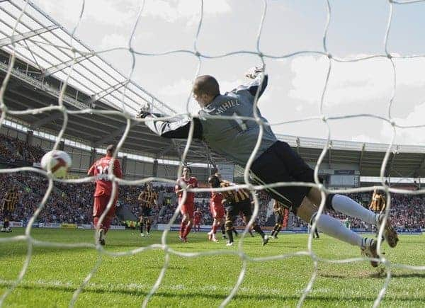 HULL, ENGLAND - Saturday, April 25, 2009: Hull City's goalkeeper Boaz Myhill is beaten by Liverpool's Xabi Alonso for the opening goal during the Premiership match at the KC Stadium. (Photo by David Rawcliffe/Propaganda)