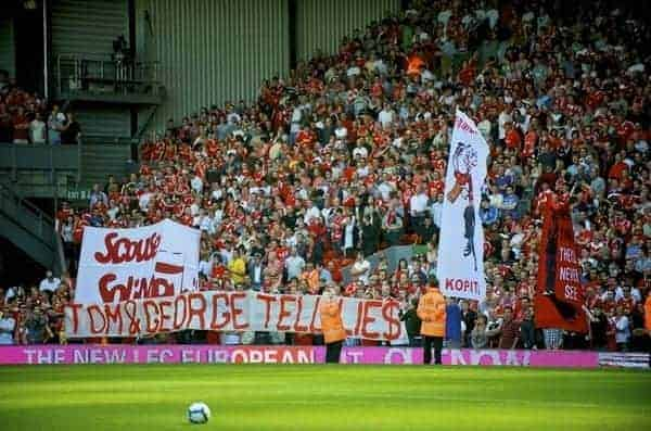 "LIVERPOOL, ENGLAND - Saturday, September 12, 2009: Liverpool supporters on the Spion Kop hold up a banner reading ""Tom & George Tell Lies