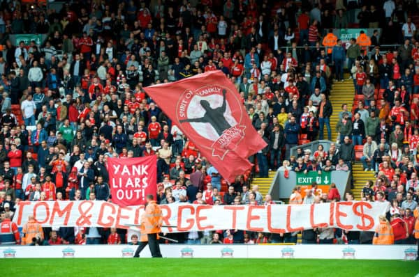 """LIVERPOOL, ENGLAND - Saturday, September 26, 2009: Liverpool's supporters on the Spion Kop display banners reading """"YANK LIARS OUT!"""" and """"TOM AND GEORGE TELL LIES"""" regarding the many broken promises made by American co-owners Tom Hicks and George Gillett, before the Premiership match against Hull City at Anfield. (Photo by: David Rawcliffe/Propaganda)"""