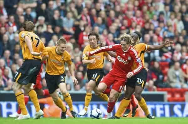 LIVERPOOL, ENGLAND - Saturday, September 26, 2009: Liverpool's Fernando Torres is chased by Hull City's Kevin Kilbane, Andy Dawson, Stephen Hunt and George Boateng during the Premiership match at Anfield. (Photo by: David Rawcliffe/Propaganda)