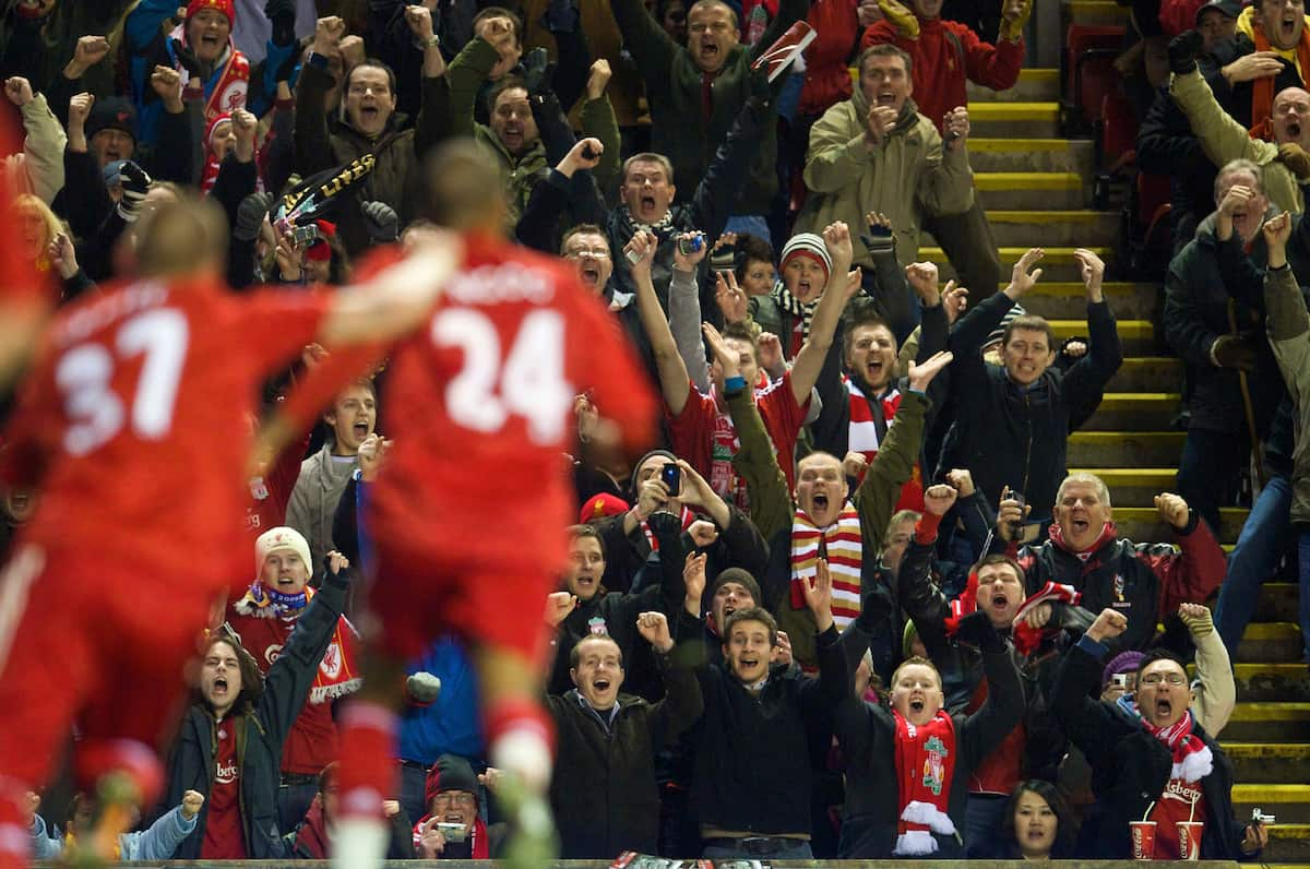 LIVERPOOL, ENGLAND - Wednesday, December 16, 2009: Liverpool supporters celebrate after David Ngog scores the opening goal against Wigan Athletic during the Premiership match at Anfield. (Photo by: David Rawcliffe/Propaganda)