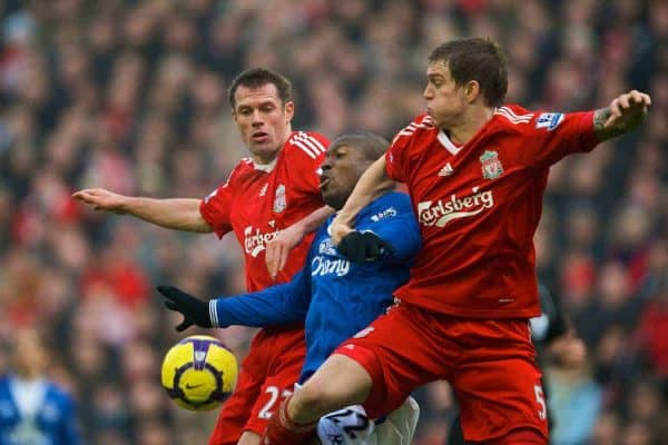 LIVERPOOL, ENGLAND - Saturday, February 6, 2010: Liverpool's Jamie Carragher and Daniel Agger muscle out Everton's Ayegbeni Yakubu during the Premiership match at Anfield. The 213th Merseyside Derby. (Photo by: David Rawcliffe/Propaganda)