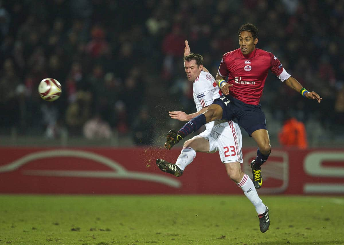 LILLE, FRANCE - Thursday, March 11, 2010: Liverpool's Jamie Carragher and LOSC Lille Metropole's Pierre-Emerick Aubameyang during the UEFA Europa League Round of 16 1st Leg match at the Stadium Lille-Metropole. (Photo by David Rawcliffe/Propaganda)