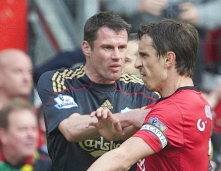 MANCHESTER, ENGLAND - Sunday, March 21, 2010: Liverpool's Jamie Carragher pushes aside Manchester United's argumentative Gary Neville during the Premiership match at Old Trafford. (Photo by: David Rawcliffe/Propaganda)