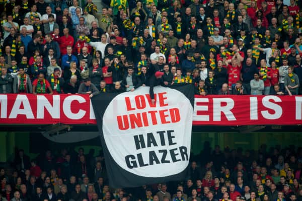 MANCHESTER, ENGLAND - Sunday, March 21, 2010: Manchester United's supporters unfurl a banner in protest against owner Malcolm Glazer during the Premiership match against Liverpool at Old Trafford. (Photo by: David Rawcliffe/Propaganda)