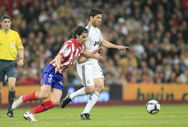 Real Madrid Club de Futbol's Xabi Alonso and Club Atletico de Madrid's Tiago Mendes during the La Liga Primera Division Madrid Derby match at the Estadio Santiago Bernabeu. (Pic by Hoch Zwei/Sprimont Press/Propaganda)