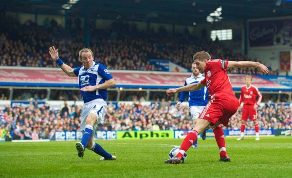 BIRMINGHAM, ENGLAND - Sunday, April 4, 2010: Liverpool's captain Steven Gerrard MBE turns inside Birmingham City's Lee Bowyer before scoring the opening goal during the Premiership match at St Andrews. (Photo by David Rawcliffe/Propaganda)