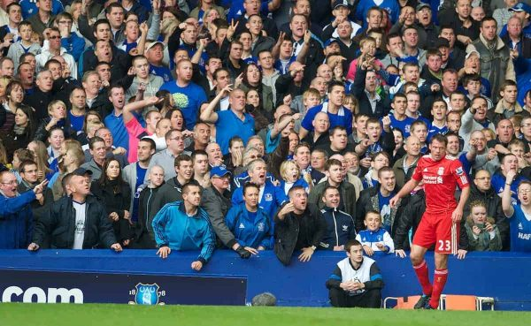LIVERPOOL, ENGLAND - Sunday, October 17, 2010: Liverpool's Jamie Carragher is abused by Everton supporters during the 214th Merseyside Derby match at Goodison Park. (Photo by David Rawcliffe/Propaganda)