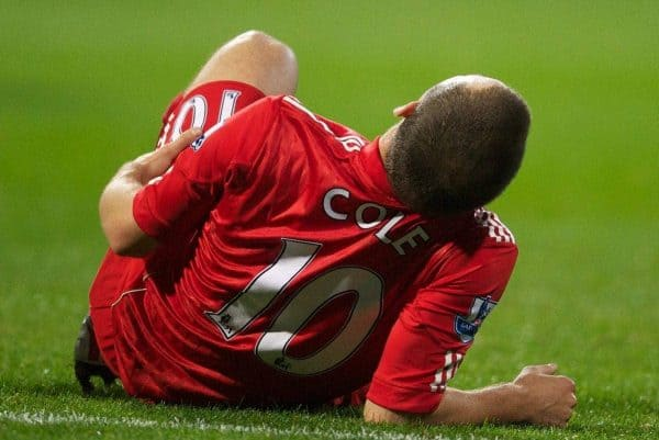 BOLTON, ENGLAND - Sunday, October 31, 2010: Liverpool's Joe Cole goes down with a suspected hamstring injury during the Premiership match against Bolton Wanderers at the Reebok Stadium. (Pic by: David Rawcliffe/Propaganda)