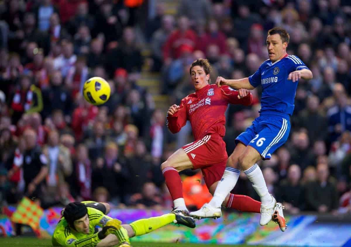 LIVERPOOL, ENGLAND - Sunday, November 7, 2010: Liverpool's Fernando Torres breezes past Chelsea's captain John Terry to score his side's opening goal during the Premiership match at Anfield. (Photo by David Rawcliffe/Propaganda)