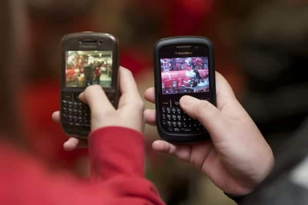 LIVERPOOL, ENGLAND - Friday, November 26, 2010: Liverpool supporters take photographs of Glen Johnson on their Blackberry mobile phones during a signing session for supporters at the Liverpool FC Club Shop at Anfield. (Photo by David Rawcliffe/Propaganda)