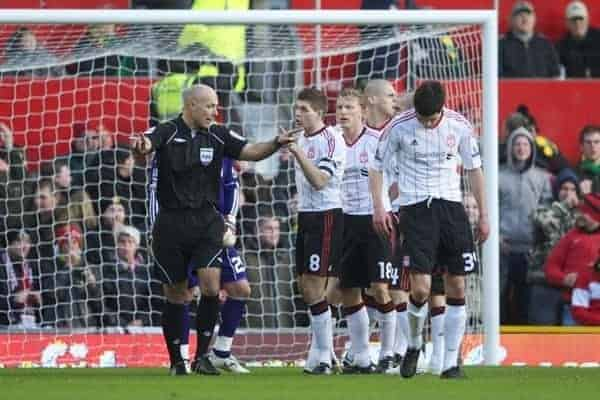 MANCHESTER, ENGLAND - Sunday, January 9, 2011: Referee Howard Webb waves off Liverpool protests as he is eager to give Manchester United a penalty in the opening minutes during the FA Cup 3rd Round match against Liverpool at Old Trafford. (Photo by: David Rawcliffe/Propaganda)