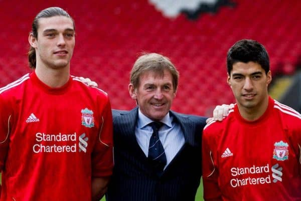 LIVERPOOL, ENGLAND - Thursday, February 3, 2011: Liverpool's new sigingings Luis Suarez and Andy Carroll with manager Kenny Dalglish during a photo-call at Anfield. Suarez signed from Ajax for 22.8m whilst Carroll arrived from Newcastle United for a club record fee of 35m (Photo by Vegard Grott/Propaganda).