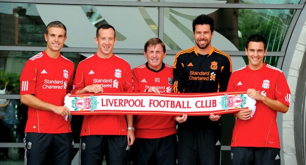 LIVERPOOL, ENGLAND - Wednesday, August 3, 2011: Liverpool's manager Kenny Dalglish with his latest signings (left to right) Jordan Henderson, Charlie Adam, goalkeeper Alexander Doni and Stewart Downing as they pose for photographers following a press conference at the club's Melwood Training Ground. (Pic by Propaganda)