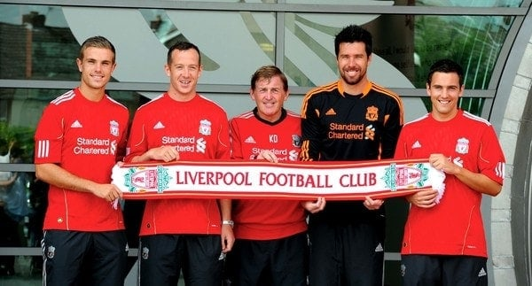 Picture by Jason Roberts...... New Liverpool signings (left to right) Jordan Henderson, Charlie Adam, manager Kenny Dalglish, Alexander Doni and Stewart Downing pose for photographers following a press conference at Melwood Training Ground, Liverpool.