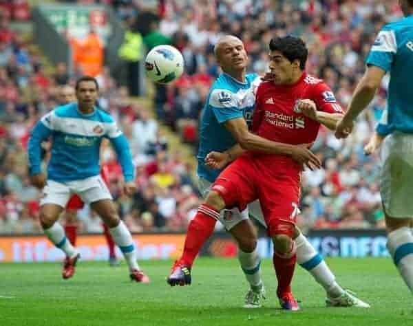 LIVERPOOL, ENGLAND - Saturday, August 13, 2011: Liverpool's Luis Alberto Suarez Diaz in action against Sunderland's Wes Brown during the Premiership match at Anfield. (Pic by David Rawcliffe/Propaganda)