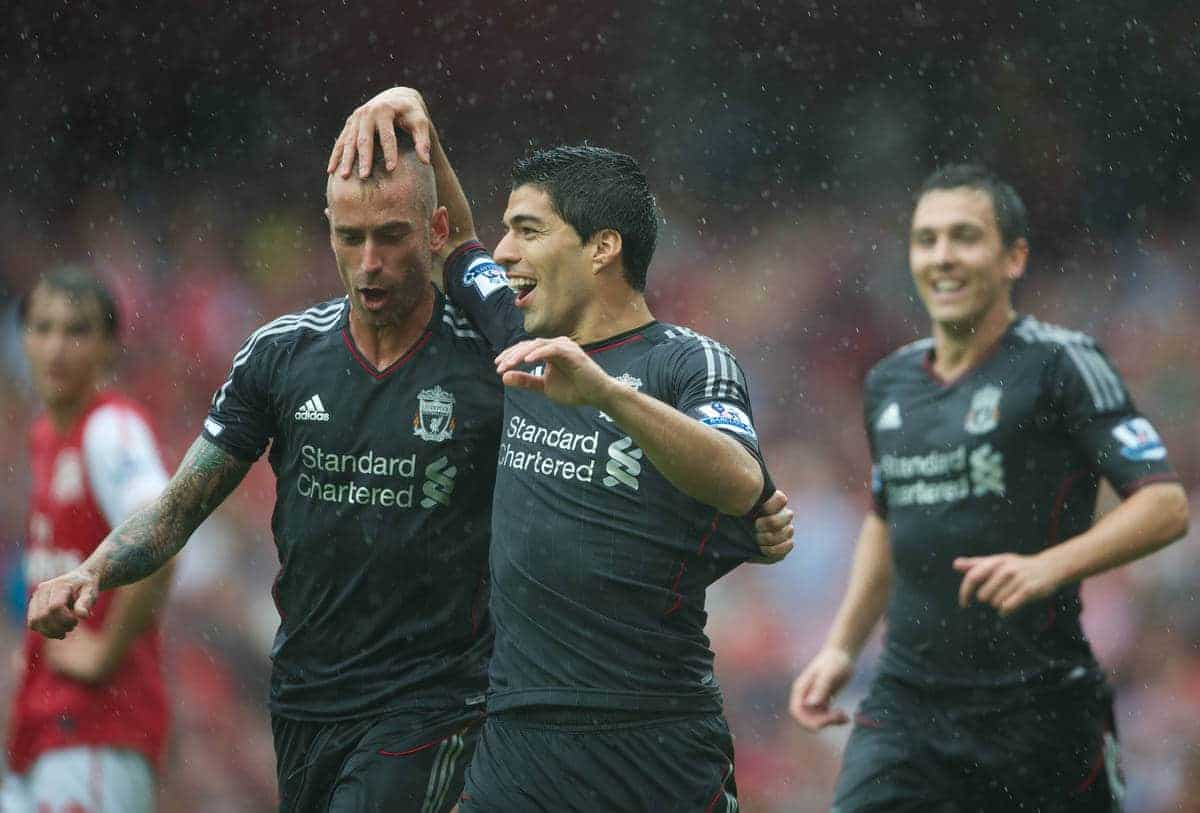 LONDON, ENGLAND - Saturday, August 20, 2011: Liverpool's Luis Alberto Suarez Diaz and Raul Meireles celebrates scoring the first goal against Arsenal during the Premiership match at the Emirates Stadium. (Pic by David Rawcliffe/Propaganda)